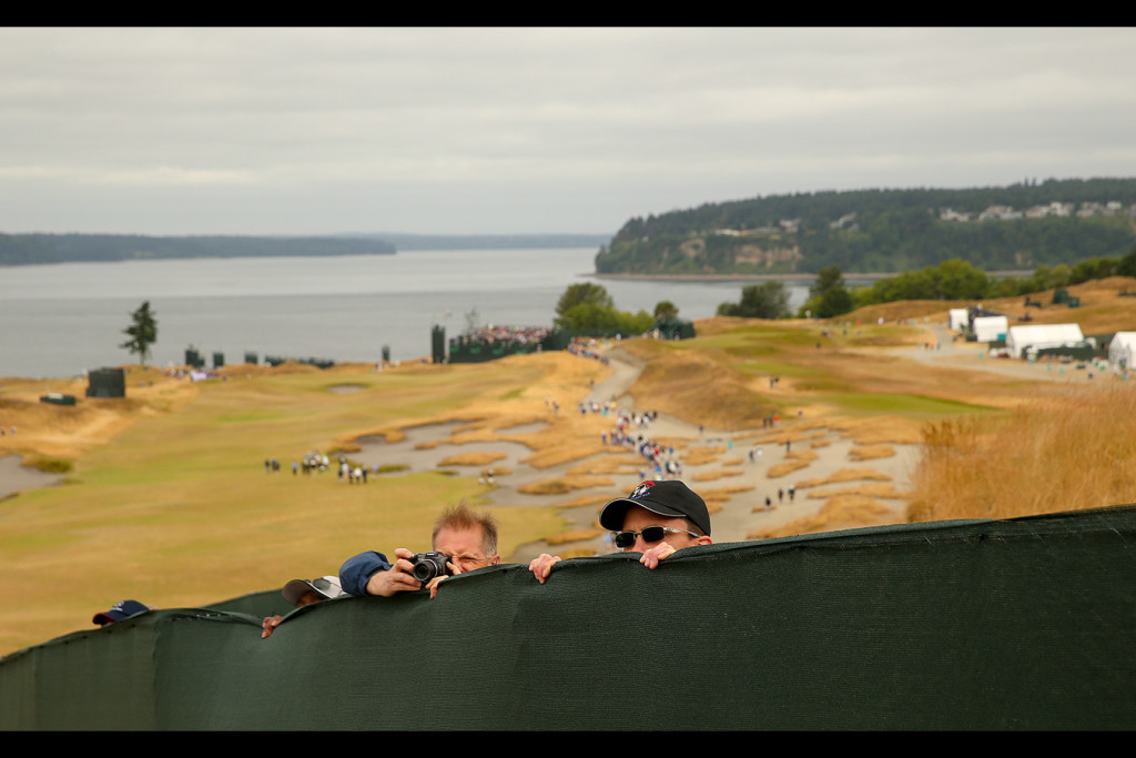 Fans look for a view of the fifth hole during a practice round for the 2015 U.S. Open at Chambers Bay in University Place, Wash. on Tuesday, June 16, 2015.  (Copyright USGA/Darren Carroll)