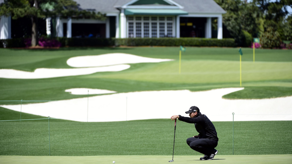 Jason Day of Australia lines up a putt on the Tournament Practice Facility at Augusta National Golf Club on Saturday, April 2, 2016.
